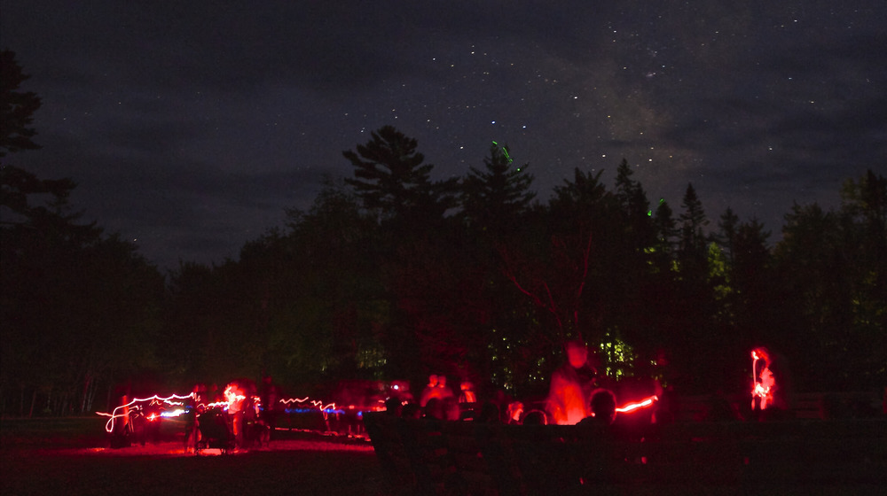 A long exposure shows trails of red-filtered flashlights used by amateur astronomers to preserve night vision. I took this shot at the 2014 Dark Sky Weekend event at Kejimkujik National Park and National Historic Site. (JOHN McPHEE)