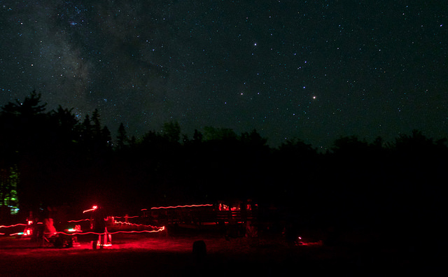The trails of red-filtered flashlights are seen during dark sky weekend at kejimkujik. (john mcphee)