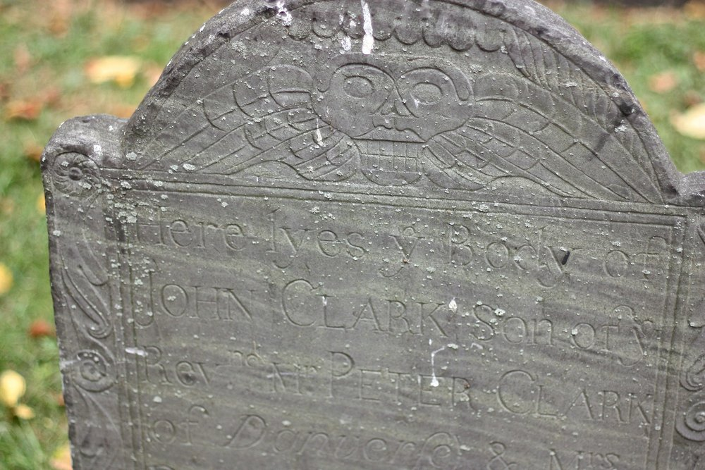 'Here lyes y body' - Detail of a gravestone in the Granary Burying Ground in Boston. (JOHN McPHEE)