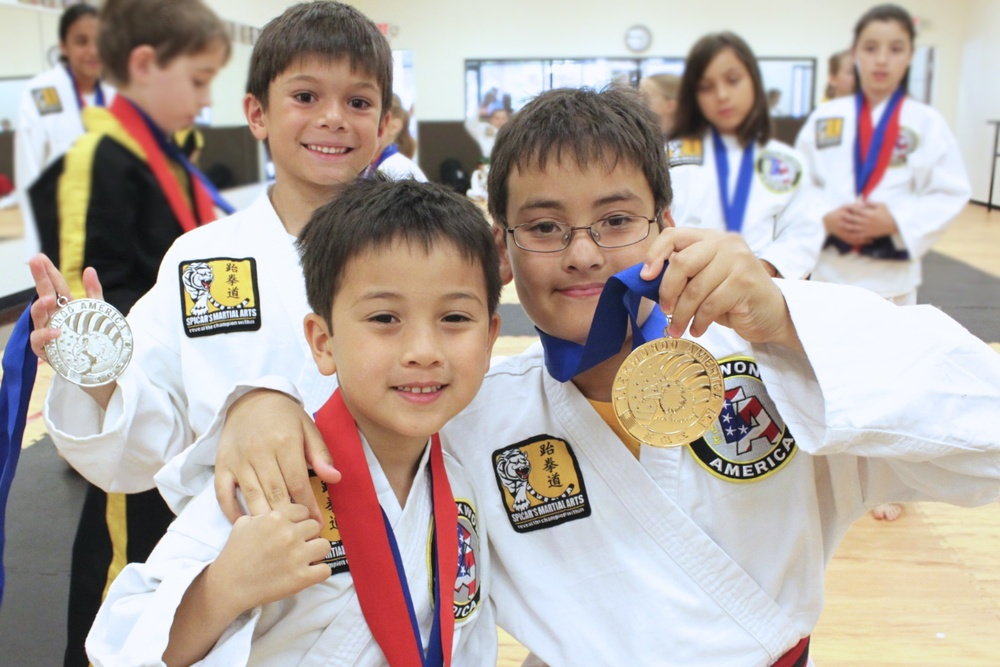 Mr. Bailey and Truman Koh and Ethan Phan showing off their medals. Congrats, boys!