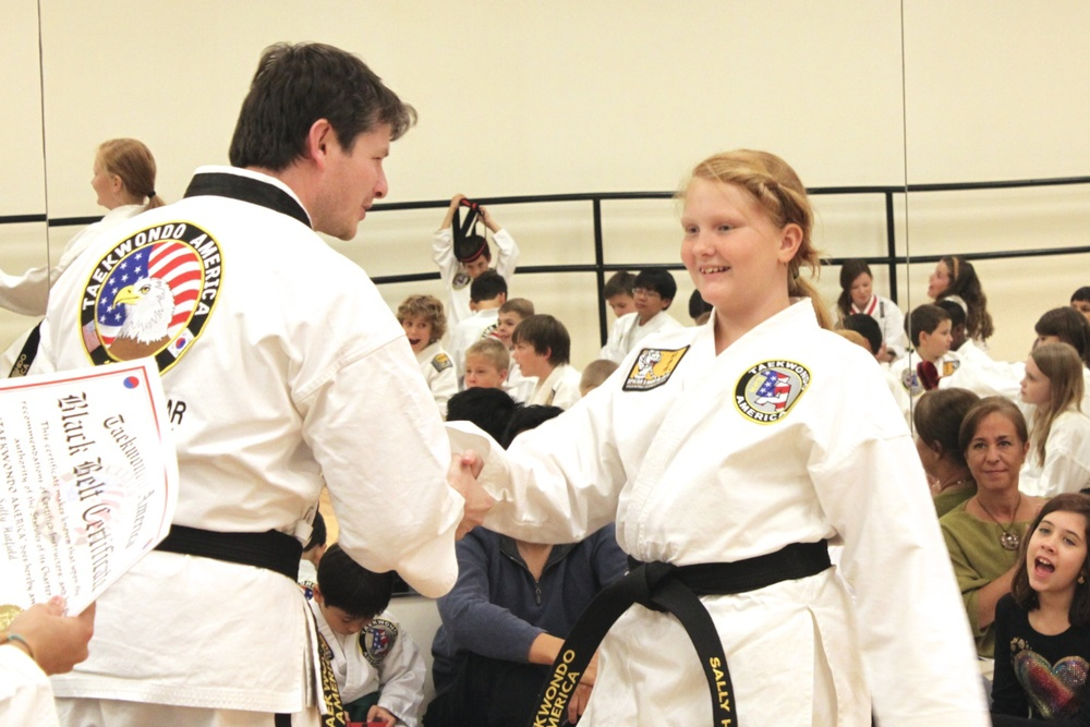 Miss Sally Hatfield receiving her 1st Degree Senior Black Belt. Congratulations!