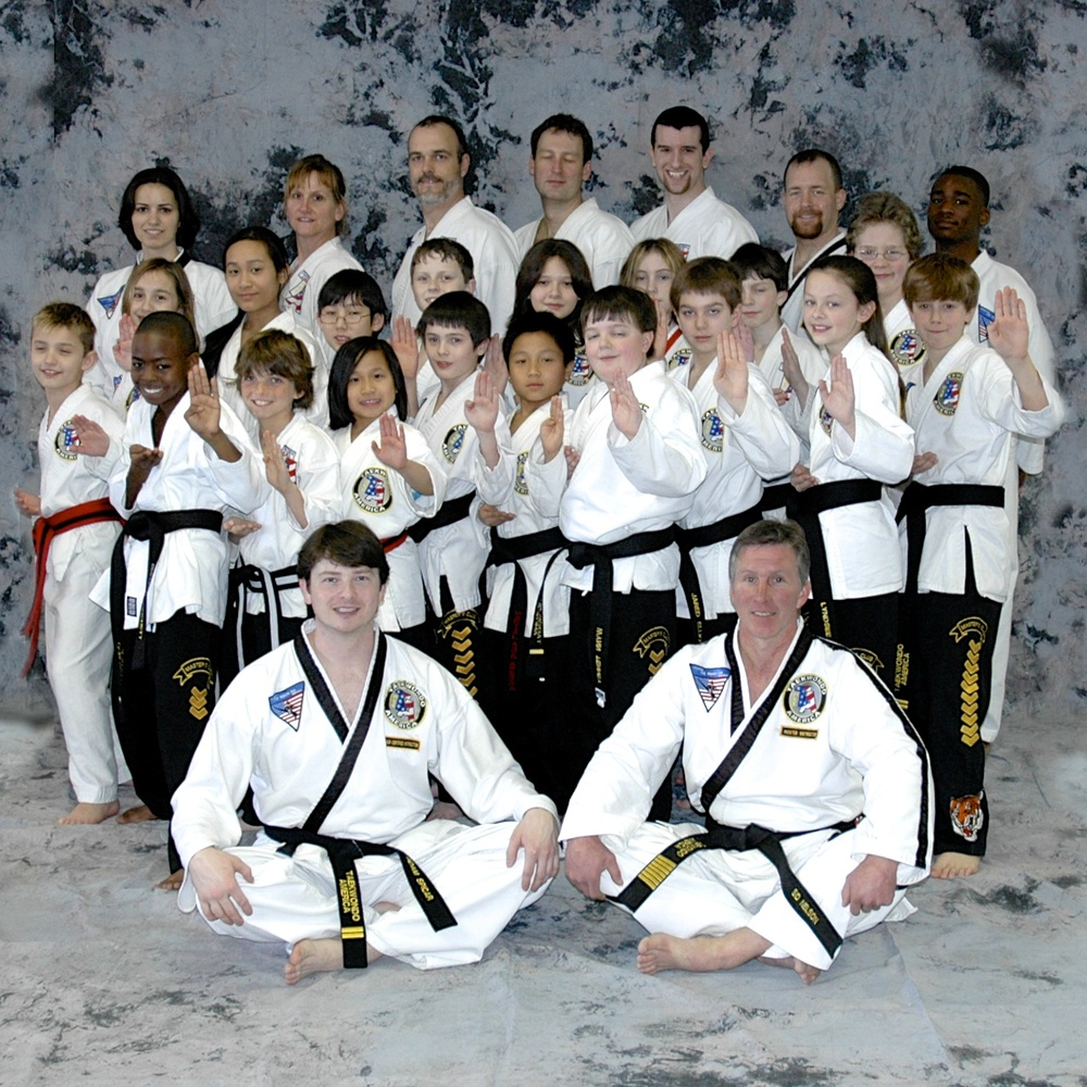 Dylan (on the right side) with pants full of chevrons in February 2008. Mr. Spicar front left, Mrs. Spicar in the back row, left.