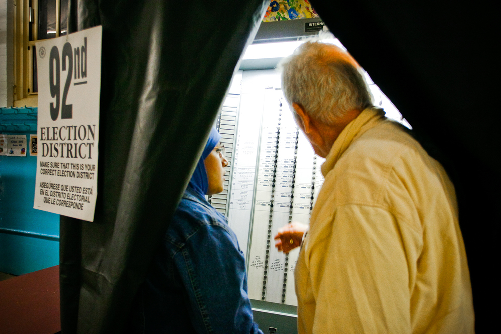 11/04/08. Bay Ridge, Brooklyn, NY. John A. McDermott, who has  facilitated voting at the polls for over 20 years, shows a first-time  Arab-American voter how to use the the machine.