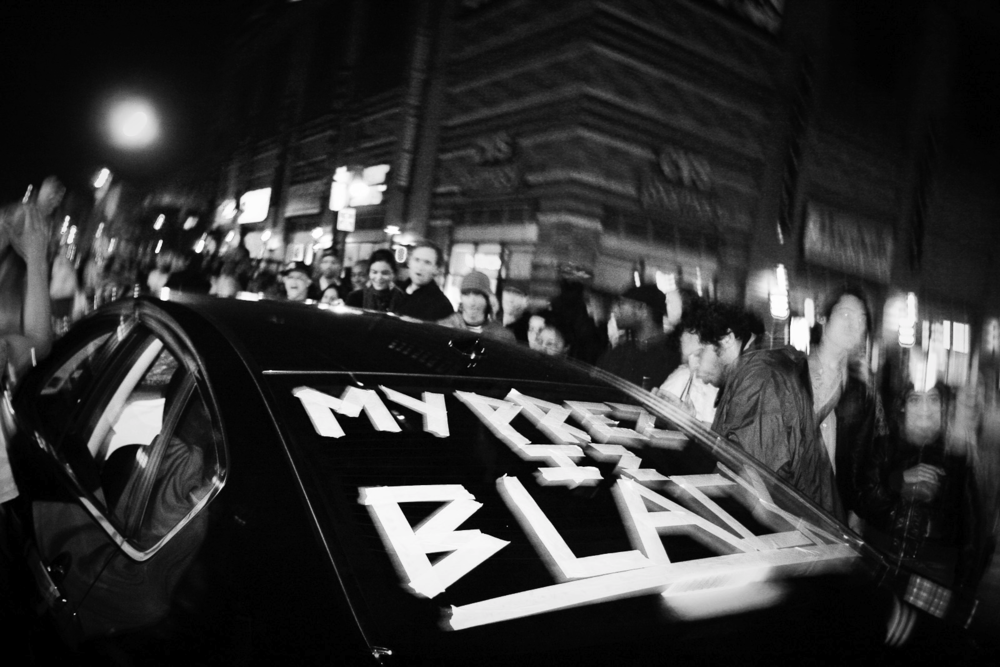 11/04/08. Harlem, New York, NY. Cheering masses crowd the streets and  block traffic to celebrate with Obama supporters driving through Harlem  just hours after Barack Obama made history by winning the election to  become the first black President of the United States.