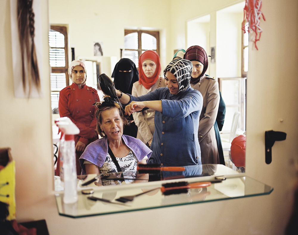 Syrian women refugees at a beauty school in a center offering job training for displaced Syrians looking for work in Kilis, Turkey.