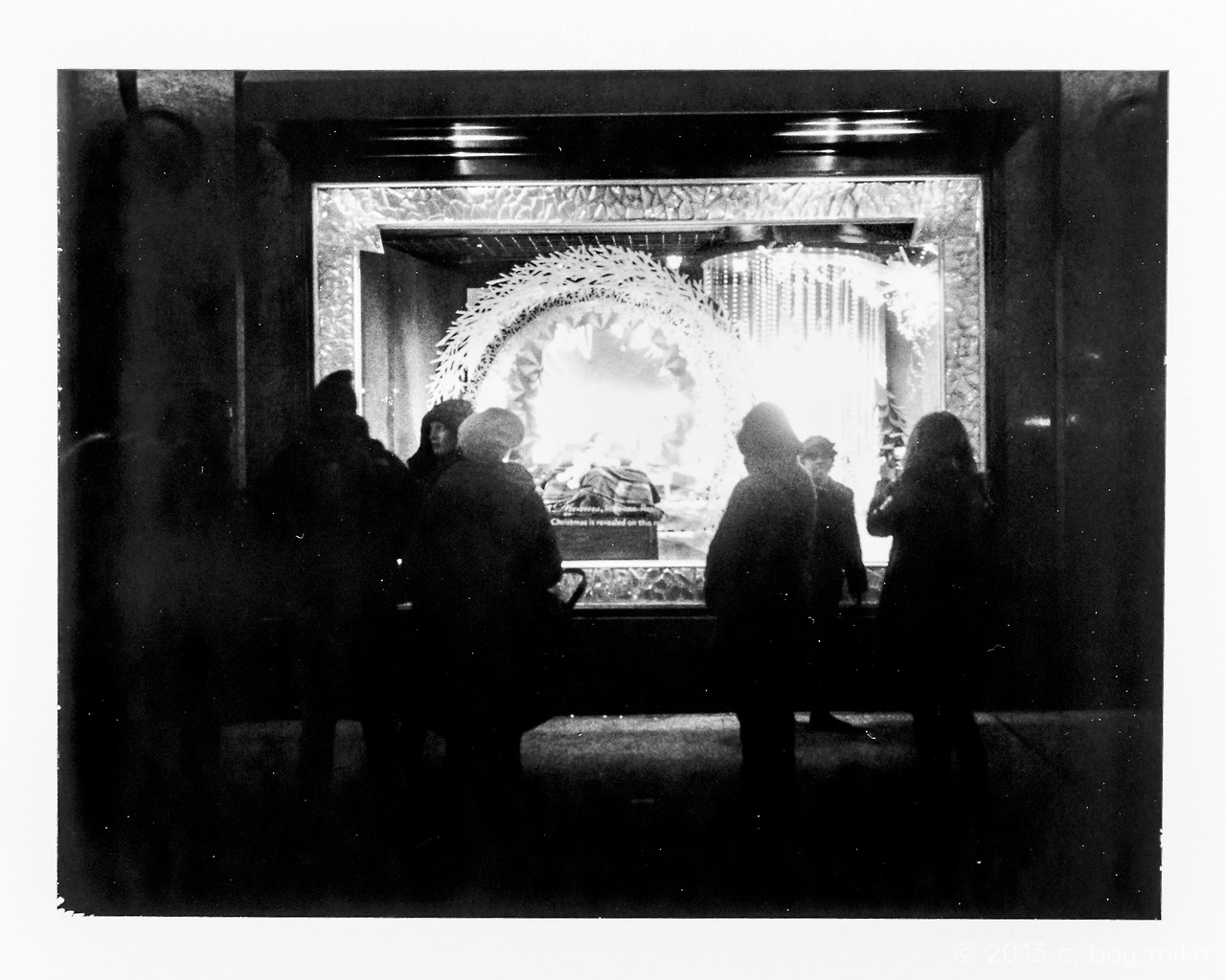 —-   onlookers gather in the nighttime around the glowing portal   they peer into and over the threshold to see a brilliant and energetic vortex of dreams looming over the sleeping body of a small boy.   his head shifts as the lights from the glittering chandelier refract and flit about as soft shines glow around the room.   a fairy fluttering about oversees the safety and comfort of the boy, as the onlookers take in the scene, and then smiling knowingly, they walk on, away, and back into the black.   —-