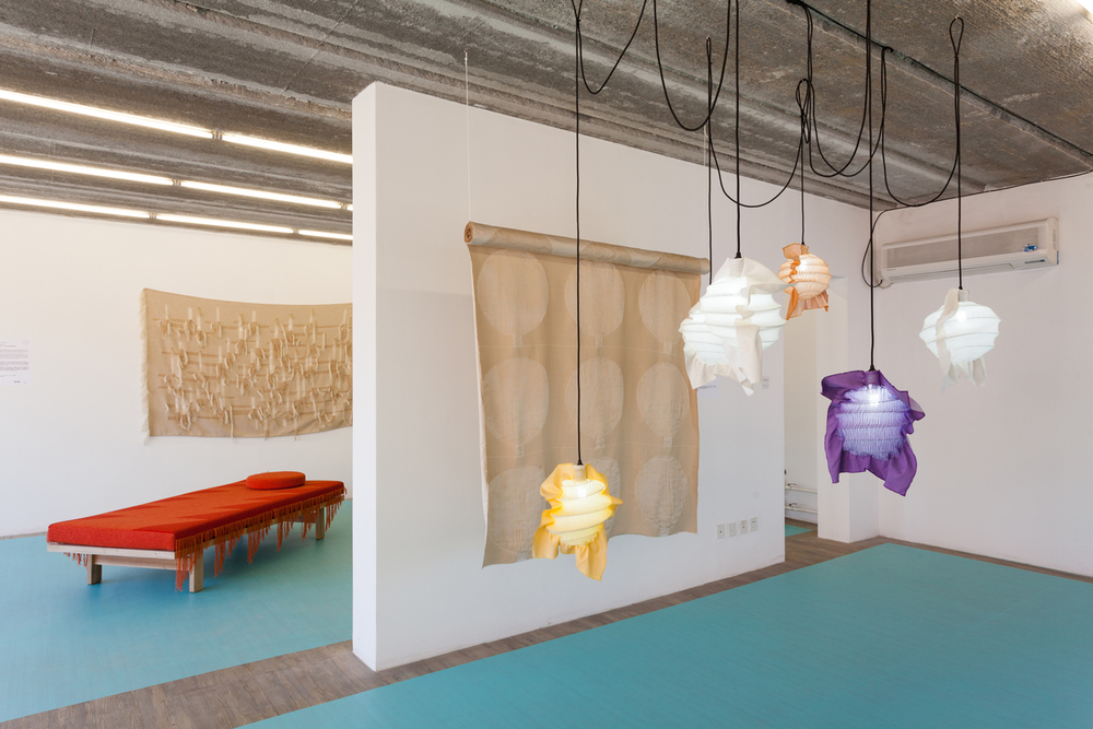 Craft & Industry by Henny van Nistelrooy: Fabricate (an industrially-woven light-shade collection, front) and Shelter (industrially-woven fabric unraveled by hand and rearranged in new geometric forms, back)