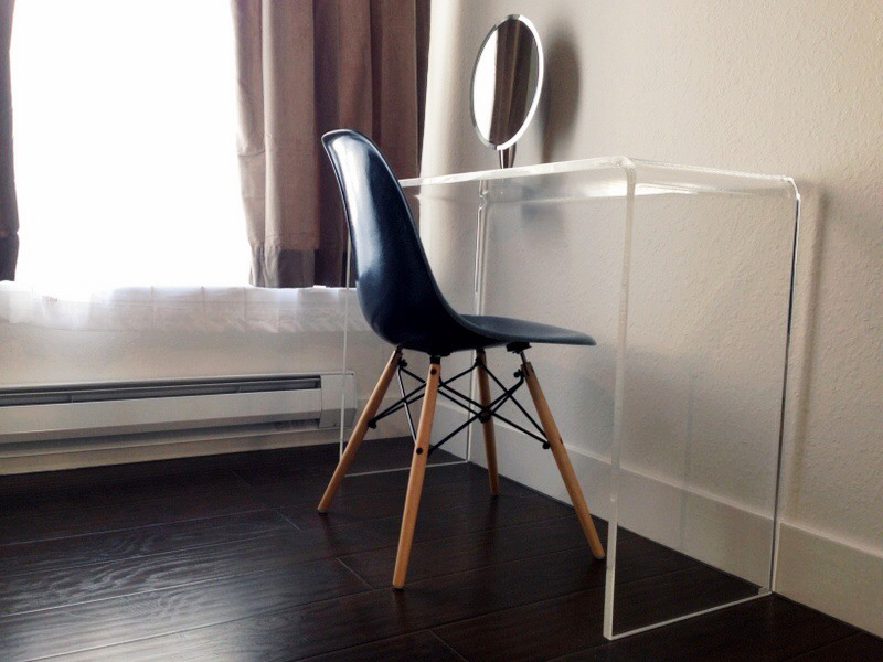 HERMAN MILLER   vintage Eames chair  (from Etsy)  / POTTERY BARN   velvet drapes (stone)   / CB2   Peekaboo clear console table