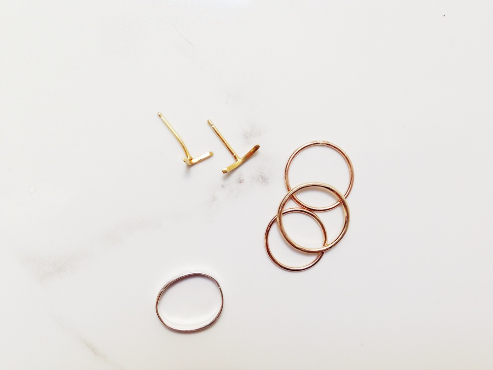 CATBIRD   Tomboy knuckle ring   / BEROEP TECH   slash ear studs   / HOMEGROWNSILVERSTONE   stacking rings (via Etsy)