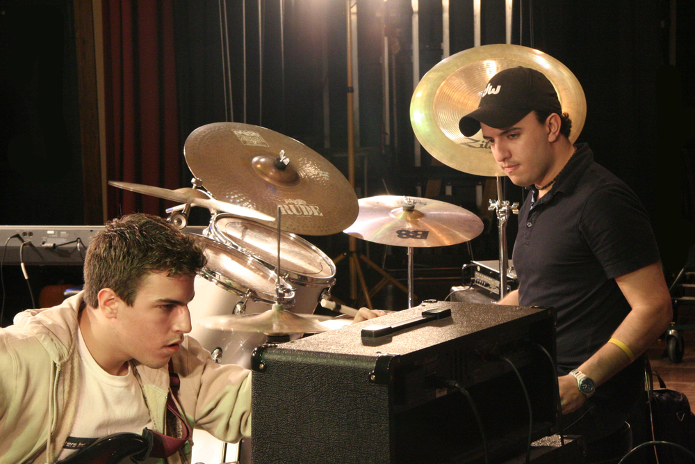Sam & former teacher Gustavo Porras setting up for the show | 2008