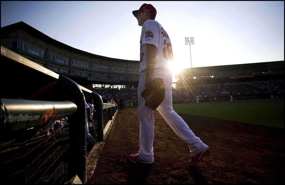 Springfield Cardinals outfielder  Chris Swauger   walks into the dugout before the start of a game  against the  Tulsa Drillers.