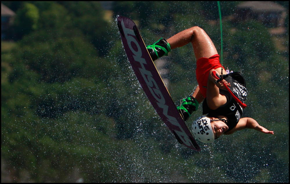 Wakeborder Corrie Dyer performs a trick while competing in the MasterCraft Pro Wakeboard tournament on Table Rock Lake.