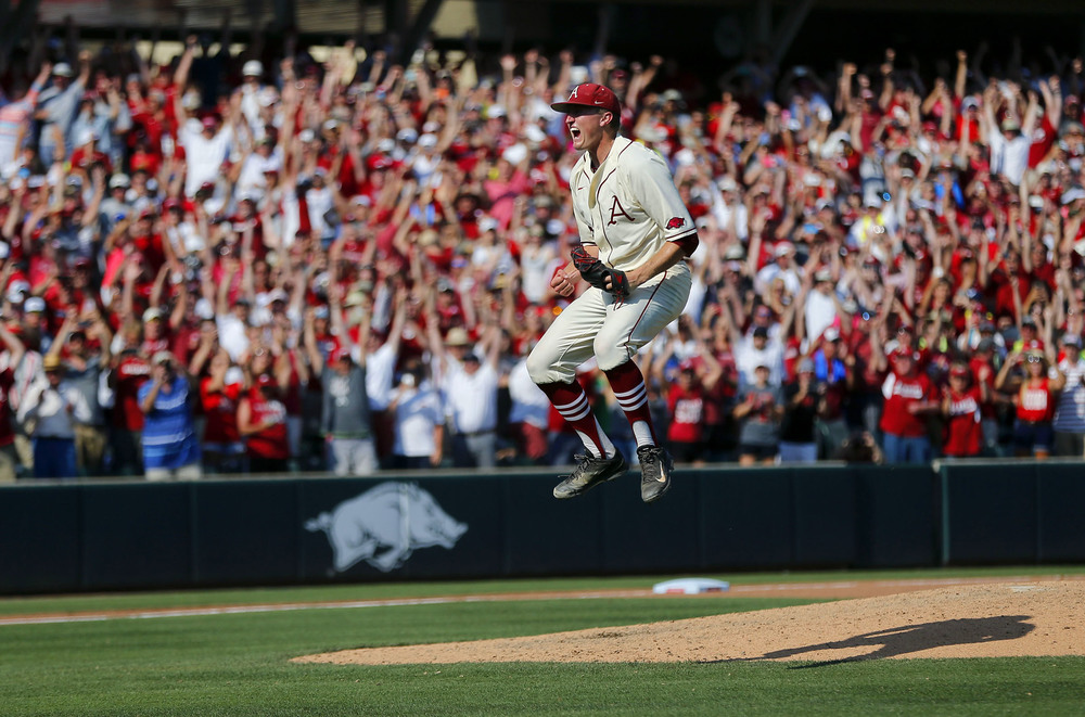 Arkansas Razorbacks closing pitcher Zach Jackson celebrates after beating the Missouri State Bears during the NCAA Division I Baseball Super Regional in Fayetteville, Ark.