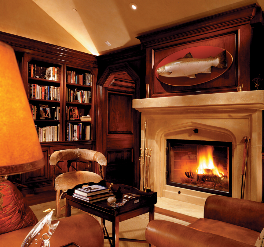A trophy fish carving by renowned artisan Ellen McCaleb adds to the sophistication of this sportsman's study.