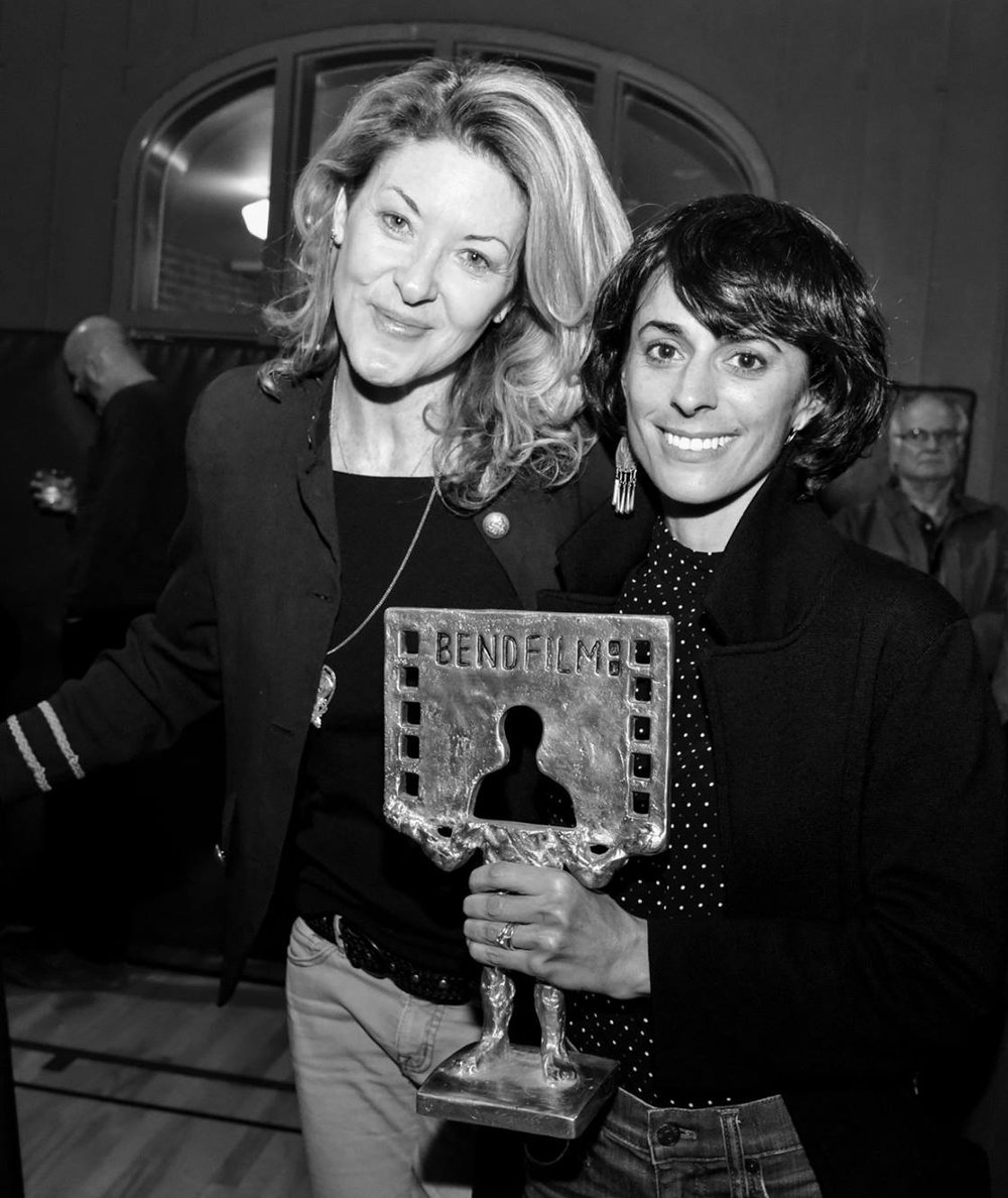 Alyssa Fedele, holding the award for Best Feature Documentary, with Ondi Timoner -