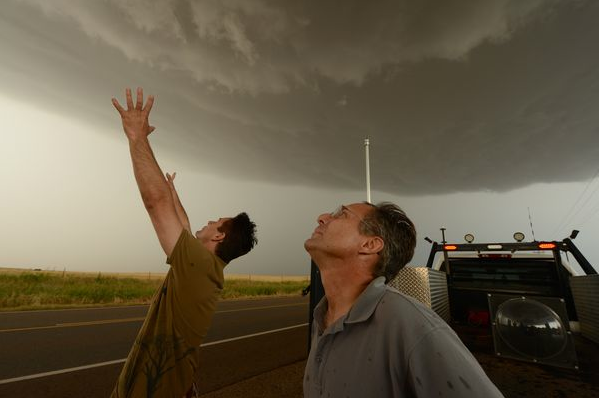 May 31st, 2014  One year ago today my three dear friends and fellow storm chasers, Tim Samaras, his son Paul and meteorlogist Carl Young were killed in the El Reno, OK tornado. They were traveling together tracking a massive storm when it violently changed directions and over took them. I deeply miss them. I was lucky enough to spend every July and August over the course of 6 years chasing lightning all over the western United States for the National Geographic Magazine with Tim, Paul and Carl. I was the camera operator filming high speed imagery with Photographer Carsten Peter. We were constantly getting as close to the most violent areas of the largest storms we could find, sometimes driving a thousand miles or more to make it to a single storm that was developing on our radar apps. Tim was a brilliant engineer and a true genius. He always put his and our safety first. I'm still shocked that it was these amazing guys who were the ones taken. During the time I spent with them we were trying to capture the birth of lightning. We had many cameras at our disposal but, by far, the most impressive was the one Tim build out of an old Beckman & Whitley 192 he bought at an auction for $600. Standing six feet high and weighing more than 1,600 pounds, the cold-war era camera was originally used to film aboveground nuclear tests. Tim retrofitted the camera, replacing the film technology with extremely sensitive digital sensors designed for deep-space exploration and adding specially tailored software and circuitry. The massive instrument was a marvel of  analog meets digital  technology. Light entering its main lens would strike a three-sided mirror, which sat at the center of a turbine driven by compressed air or, for really high speeds, helium. Rotating as fast as 6,000 revolutions per second, the mirror swept the light across the sensors resulting in an image sequence of more than 1.4 Million FPS. He called it the Kahuna. I will always miss those guys. RIP.