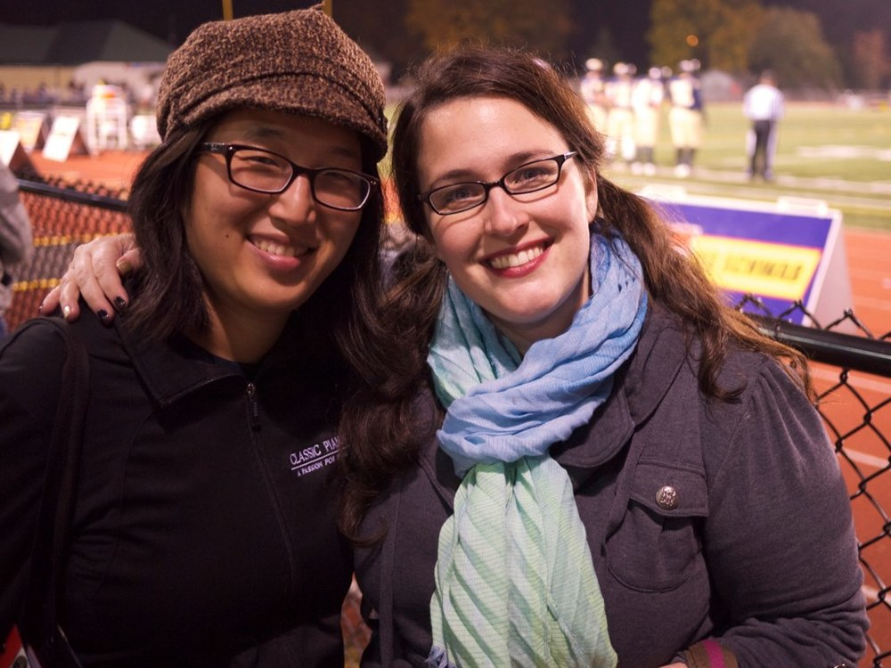 Sarah & Laura at a high school football game in Sarah's hometown.