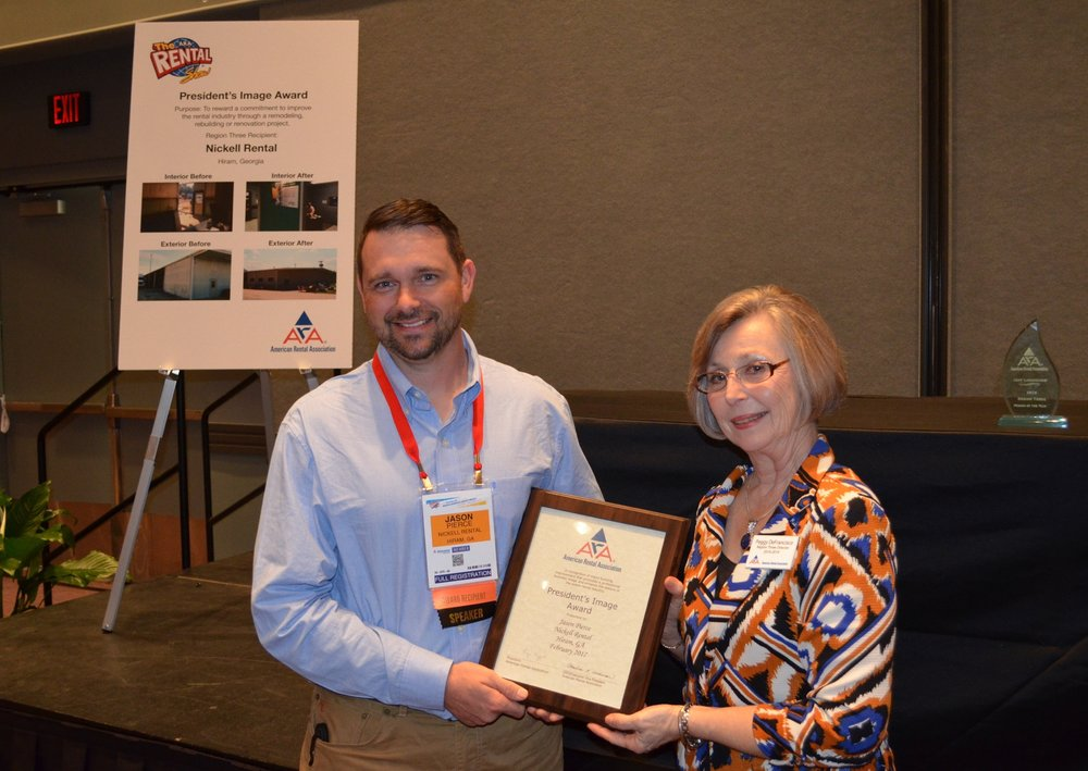 Hiram Branch Manager, Jason Pierce accepts the President's Image Award from ARA Region Three Director, Peggy DeFrancisco at The Rental Show in Orlando, Fl.