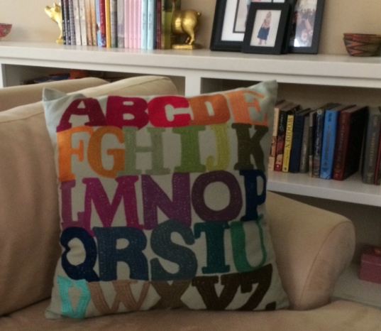 So to mark the moment, I bought this beautiful hand stitched pillow from the shelves of BookSoup -- a one-of-a-kind work of art. It contains everything you need to tell a good tale, so I thought it was appropriate. What better what to mark the occasion -- supporting another artist, being part of someone's story, keeping the love alive!