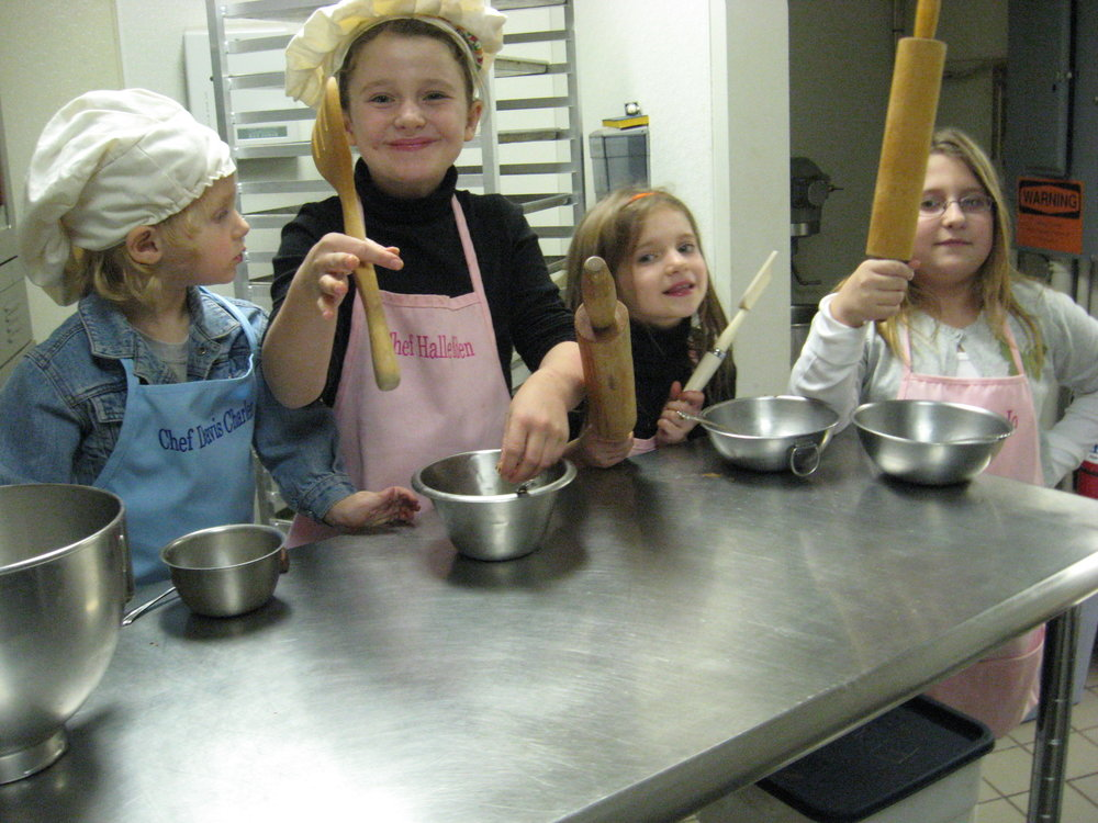 BIRTHDAY PARTIES!   Kids have a blast at the bakery! They get to make minis cheesecakes and take them home that day! Stay at the bakery after baking to open gifts and have snacks. We have chairs, tables, linens, music, water, serve ware, cheesecake and pizza (ordered in) available for your parties!   Capacity:  10-35. Cost: $7/attendee. $20/hour space rental after first 30 min. (Takes about 30 min to make the mini cheesecakes)   What's included in fee:  2 Cupcake Cheesecakes to take home per child. They will get to make their own cupcake cheesecakes. *Gluten free available upon request.   Times Available: 2-5p Saturdays, 1-4p Monday thru Thursday, Tuesday nights.