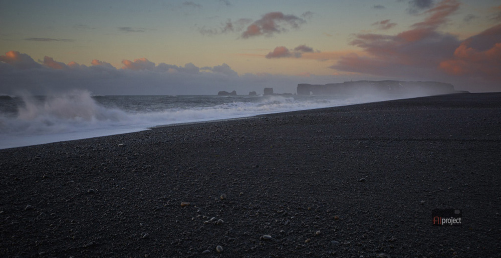 Black sand beach at Vik looking west towards Dyrhólaey, South Iceland.