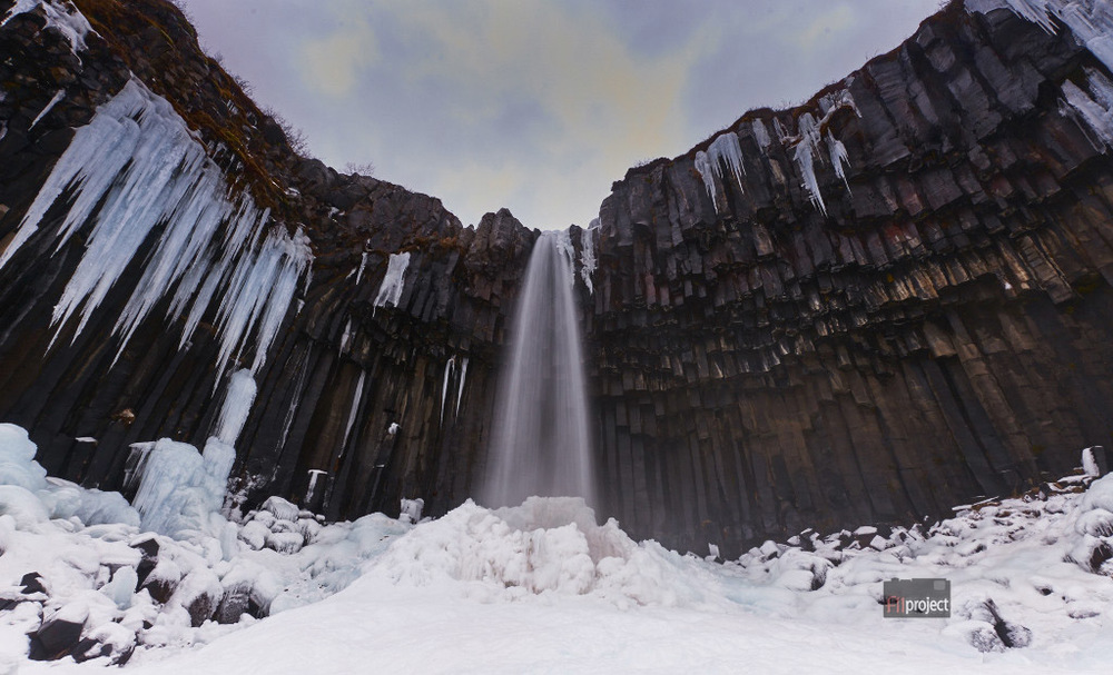 Svartifoss or Black Waterfall at Skaftafell, South Iceland. The hanging hexagonal basalt columns on the sides resembles the wings of angel.
