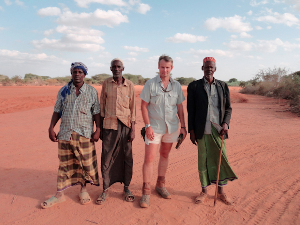 Ian Saunders from TSAVO TRUST with community elders, before the formal meetings when long trousers were donned (by Ian anyway!)