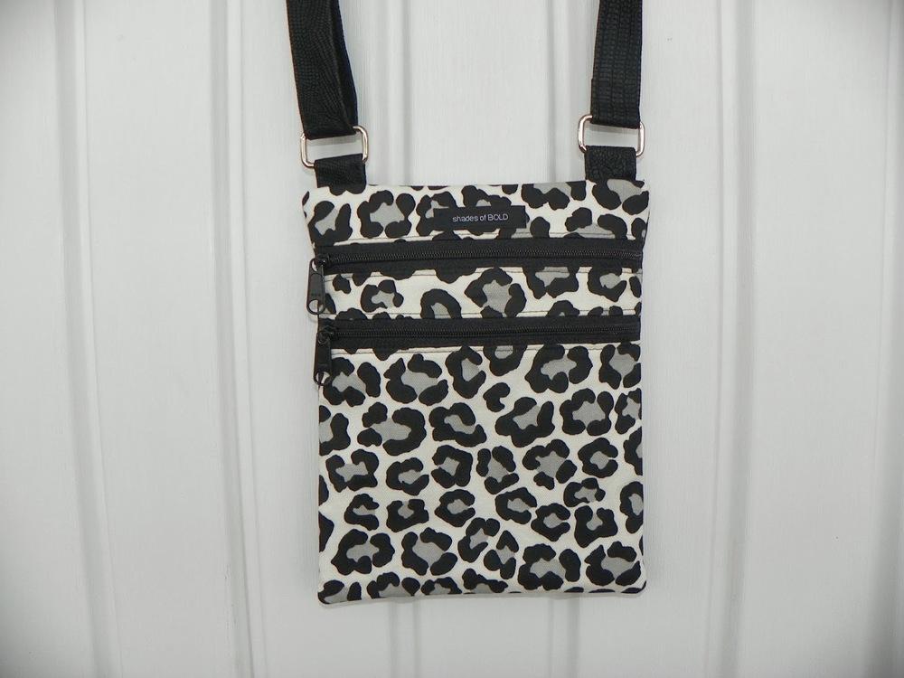 white leopard zip and go.jpg