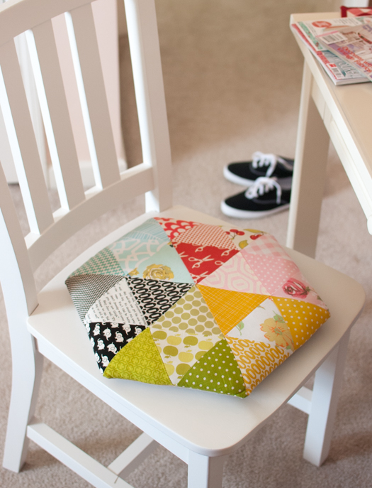"""A cute"" triangle pillow from Retro Mama"