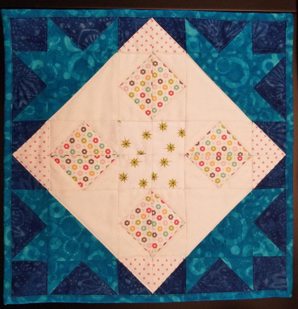 An Eclipse mini quilt made by Candace!