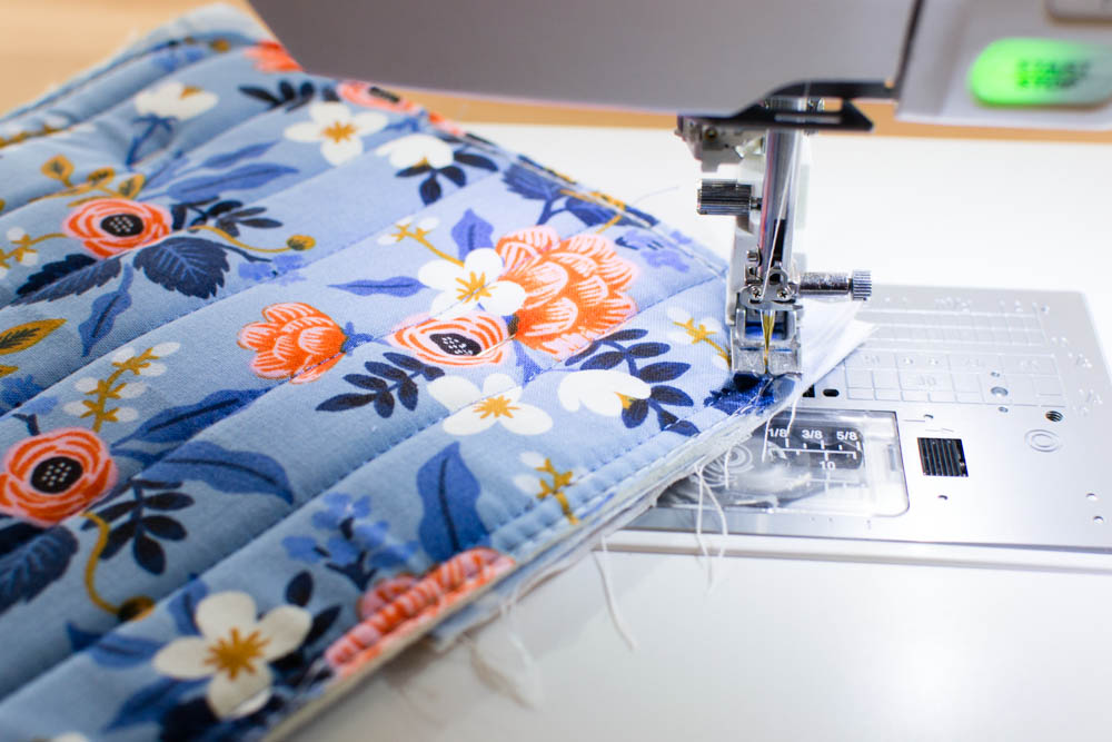3d4902c85e24 Flip the piece over and stitch the layers together from the quilted side so  you can sew around the curved corners - sewing 1 8   - 1 4   from the edges  of ...