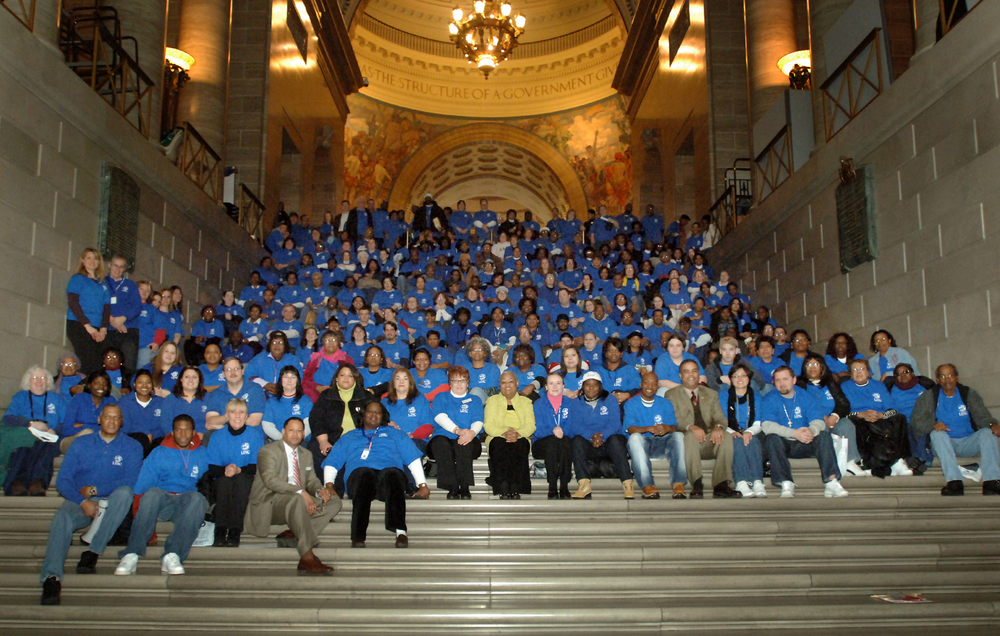 LINC staff, volunteers and community members gather on the steps of the Missouri State Capitol for the 2006 Child Advocacy Day.