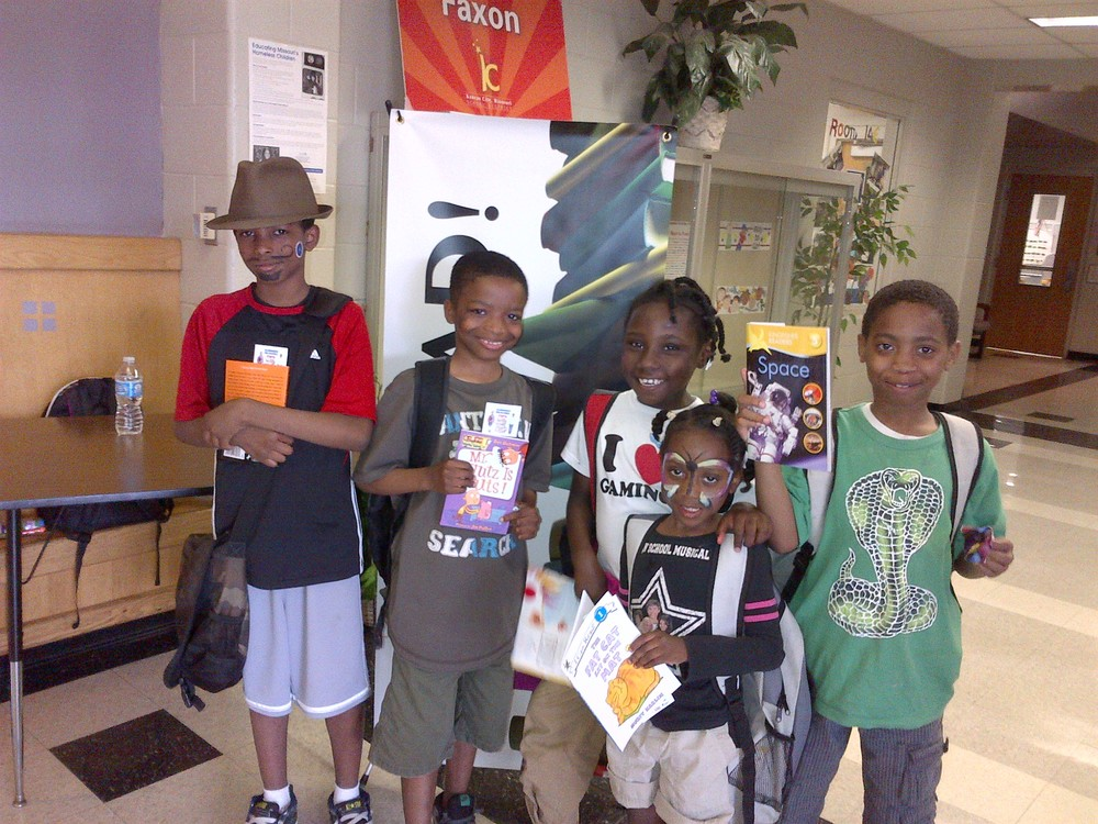 Students from Faxon Montessori with their new books.