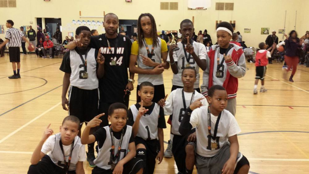 Coach Andre Allen and the winning Center Elementary team