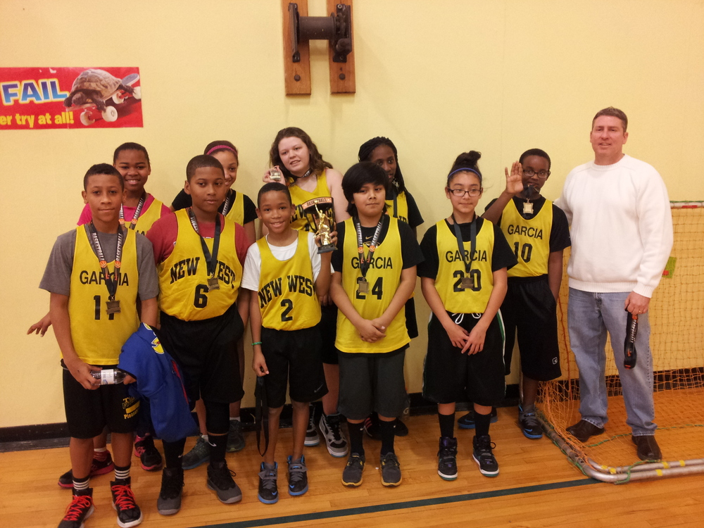 Coach Danny Woodsmall and the winning Garcia  Elementary team