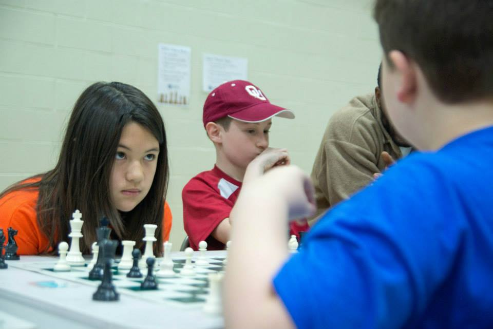 A LINC Chess student from Chouteau Elementary in the North Kansas City School District prepares to make her next move.