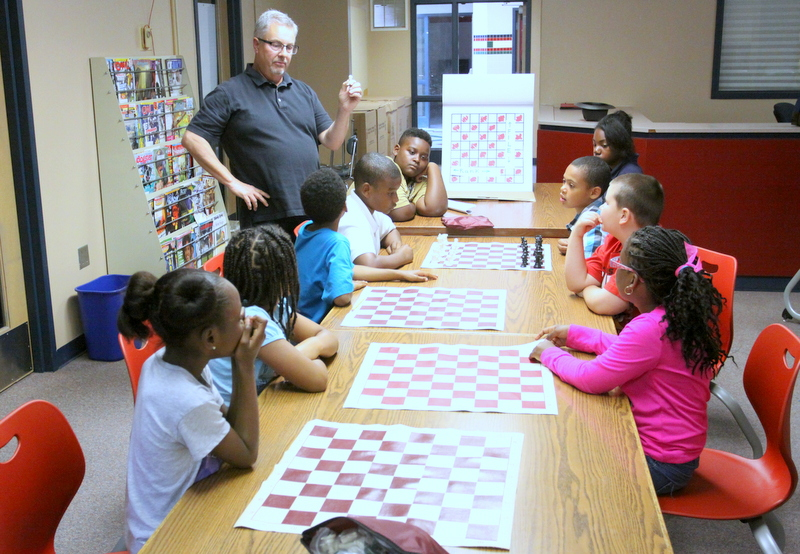 Students at Melcher Elementary in Kansas City Public Schools play chess during LINC Summer School.