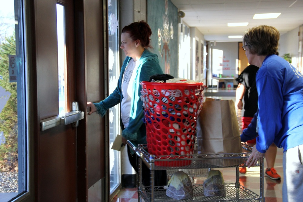 Residents receiving food and gifts at Cler-Mont Elementary.