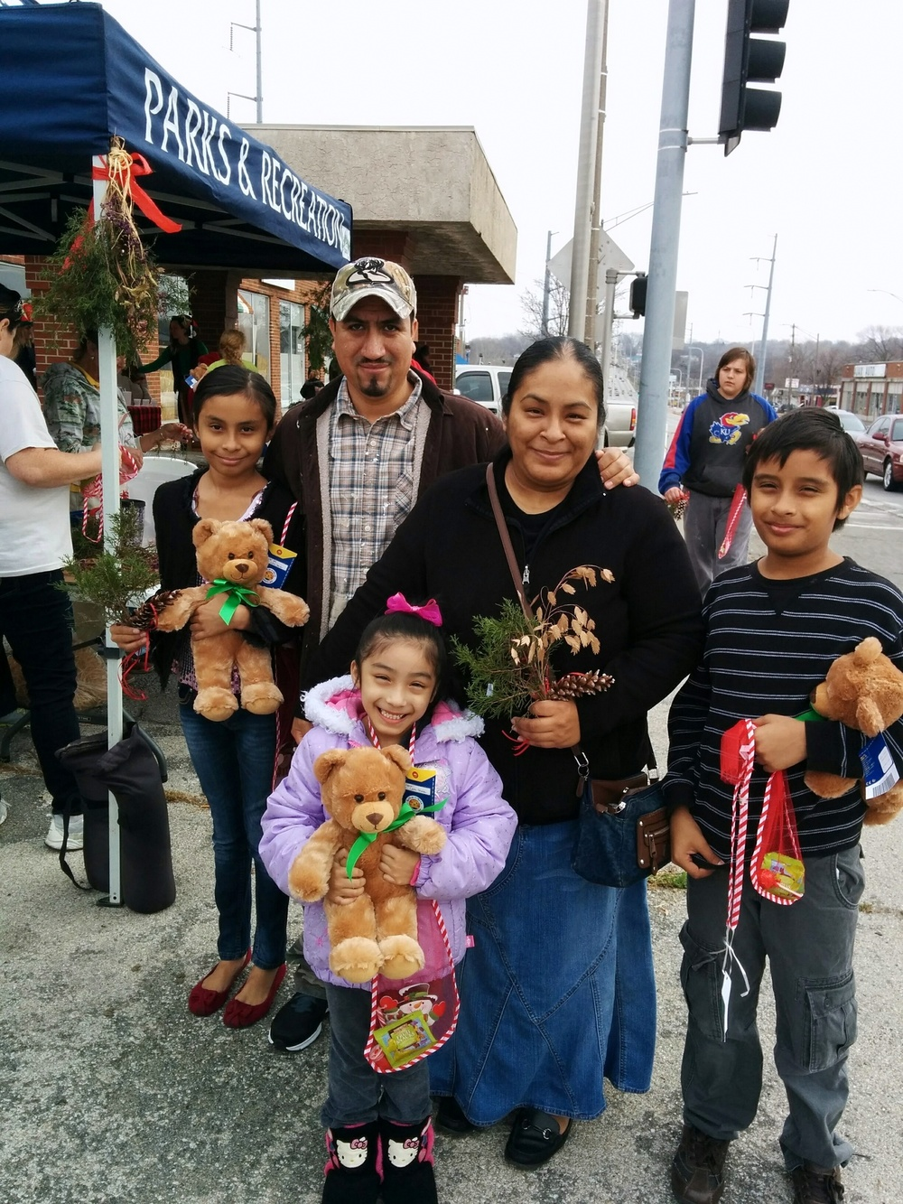 Families celebrate the holidays during the Second Annual Christmas Block Party in the Fairmount Business District.