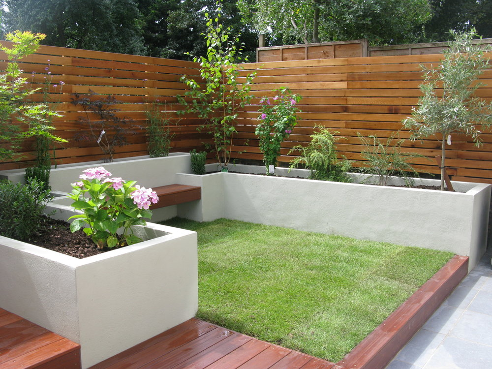 Porcelain Paving , Hardwood Decking And Geometric Raised Beds Were Used To  Give A Contemporary Feel . Slatted Cedar Screening Provides Privacy To This  ...