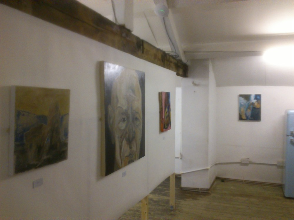 The paintings sat very well on the new walls even though they were paper. We have myself, Kelly and Dave's work here.