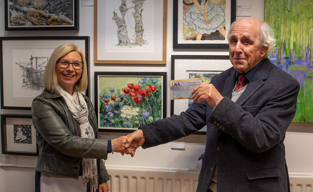 Trustee and Art Historian, David Phillips awarding Julia Essex at the Private View