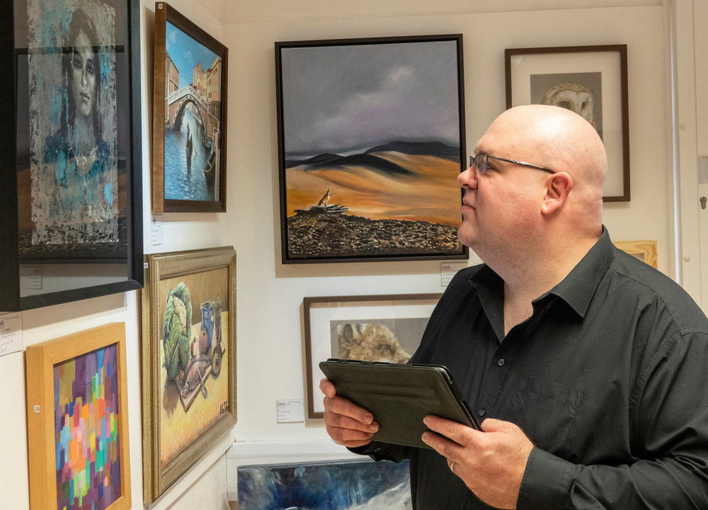 Artist and historian Marcus White judging the wonderful art featured in the gallery