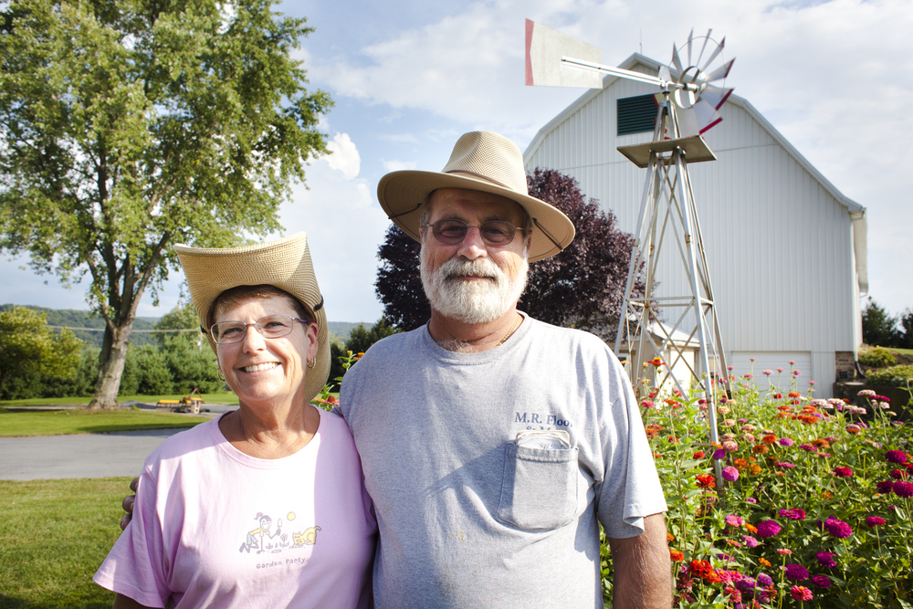 A portrait of Marie Rudy and Michael in front on their home property at Mount Wolf, Thursday, Aug. 22, 2013.