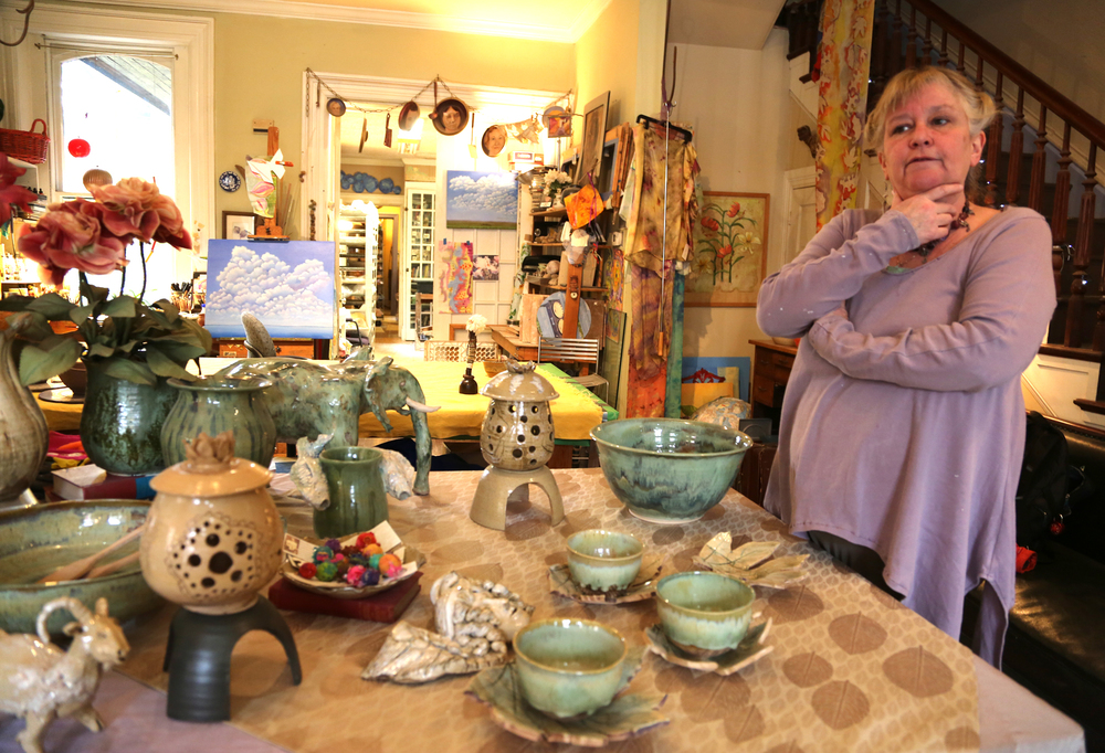 Kim Heindel-Toner, organizer of Artists' Studio Tour: Makers Dozen, stands among her handmade pottery items at her studio and shop Terra Opera Pottery in York.  Photo by Sonya Paclob