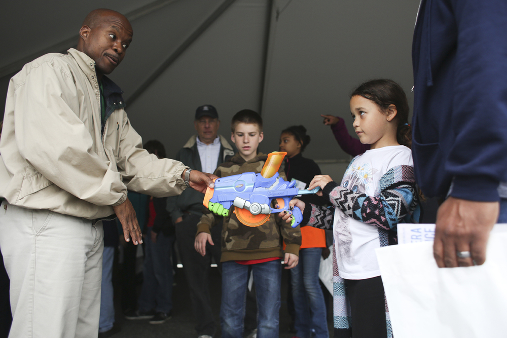 From Left, Staff Dr. Paul Gaye holds a Nerf Gun to demonstrate proton therapy to seven-years-old Olivia Waltz and William Waltz of Hampton at the Jefferson Lab Open House in Newport News, Saturday, April 30, 2016. (Sonya Paclob / Special to the Daily Press)