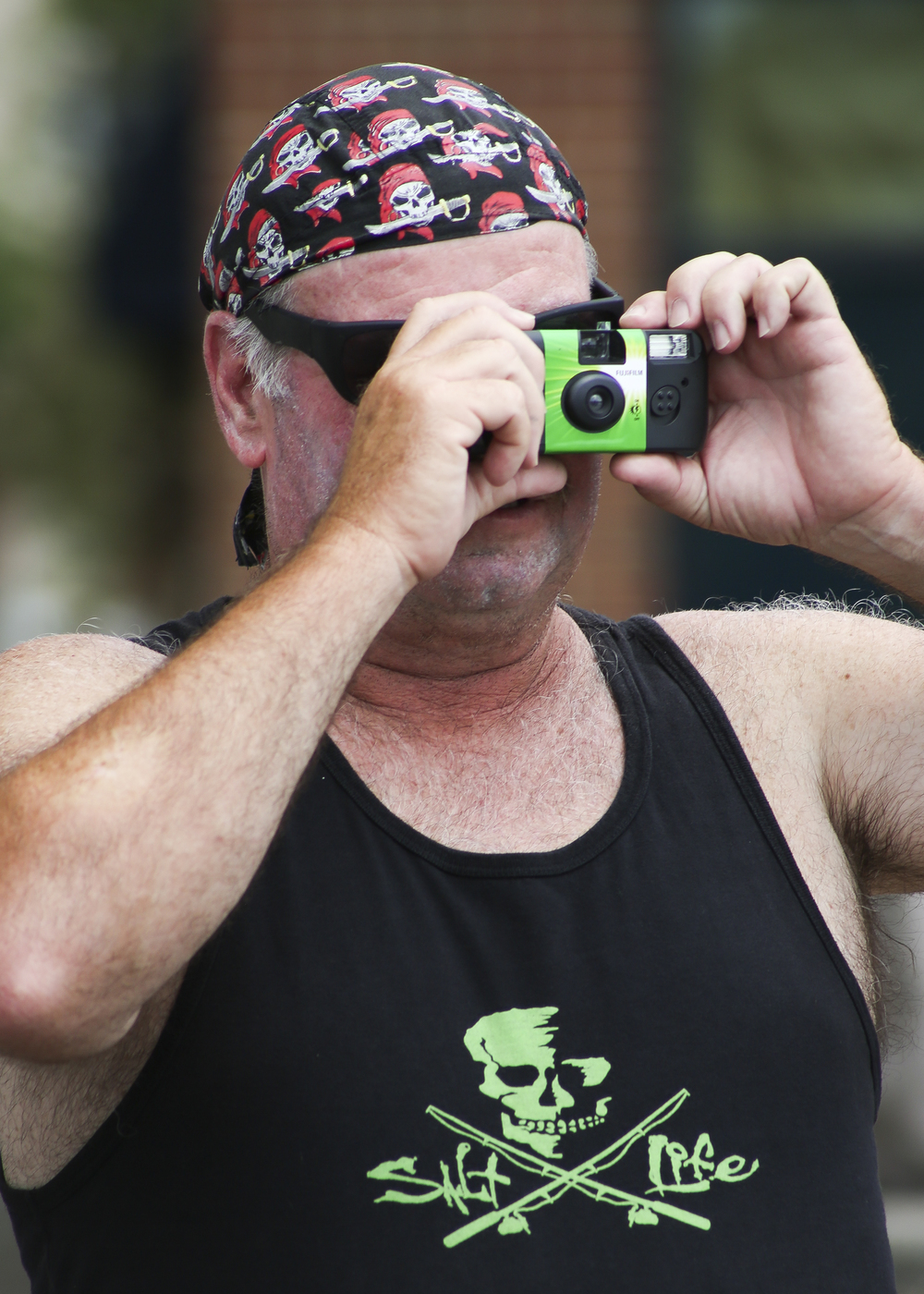 Lenny Temple of Moyock, North Carolina takes a picture with his disposable camera during the Blackbeard Pirate Festival, Hampton, Saturday, June 4, 2016. (Sonya Paclob / Special to the Daily Press)