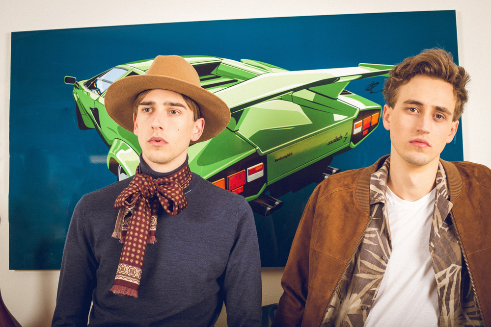 Oliver is wearing a Liberty or Death hat.  Green Lambo Countach  by Katja Peter, Visual Dope.