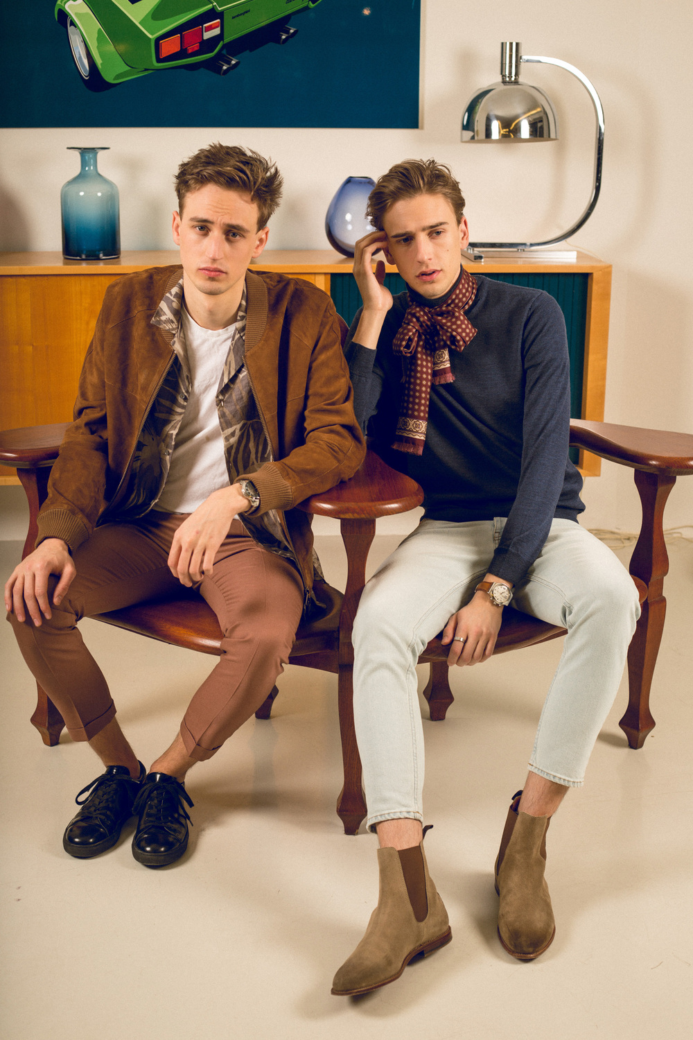 Moritz is wearing an AMI suede jacket, Drykorn shirt, Paul Smith trousers and Sandro sneakers. Oliver is wearing an Oscar Jacobson rollneck sweater, Paul Smith scarf, Acne jeans and Windsor boots. Sitting on a  bench by Antoni Gaudí for Casa Batlló .