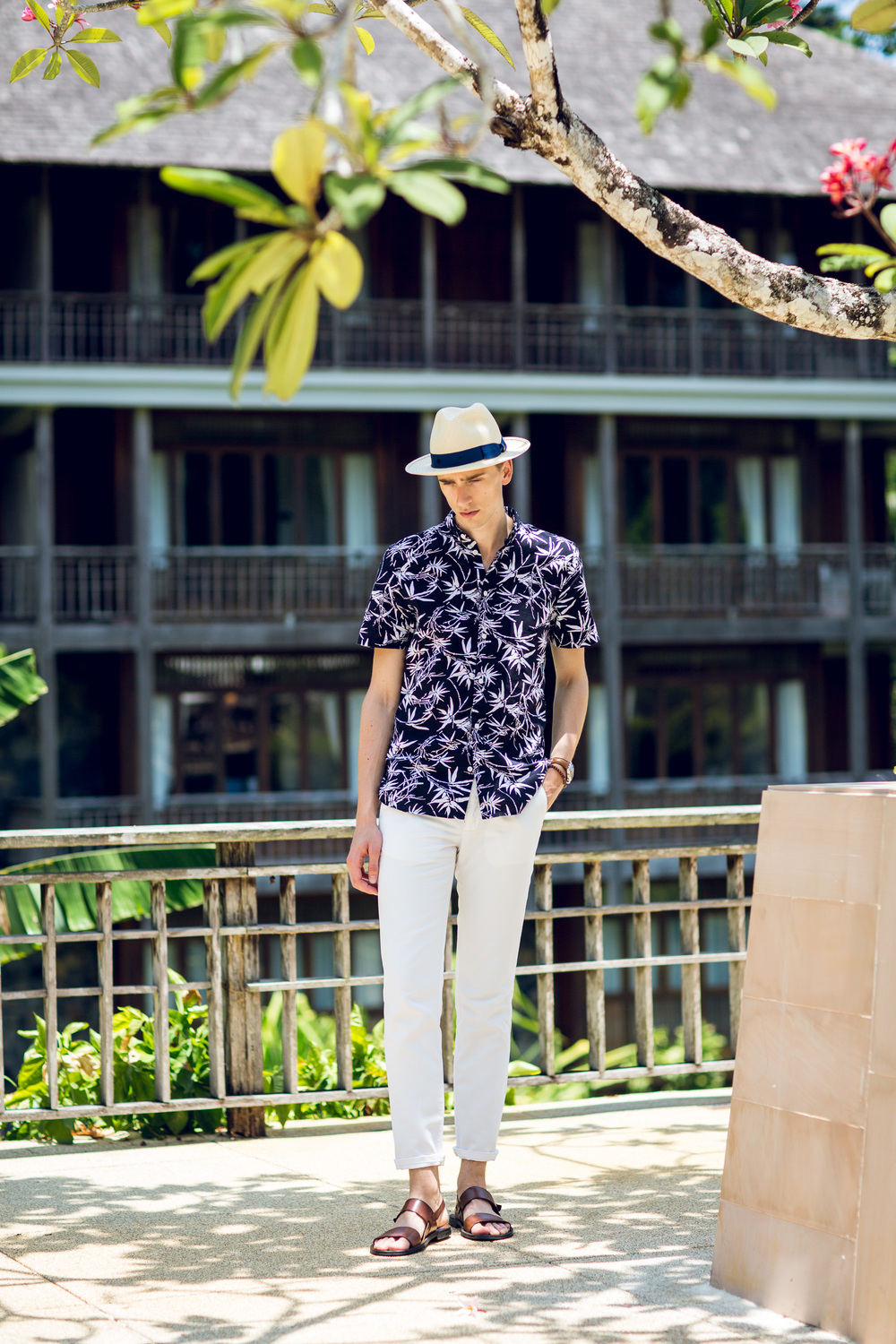 Resort Chic - Wearing a Borsalino Panama hat, H&M palm printed shirt, GANT trousers and leather sandals.